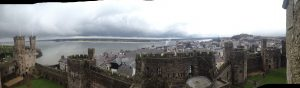 Caernarfon Castle, the city, and the Strait of Anglesey.