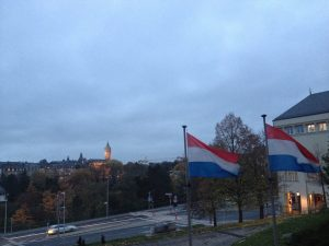 Flag of Luxembourg, from my brief stopover in the fall. The single car on the road does not reflect reality.